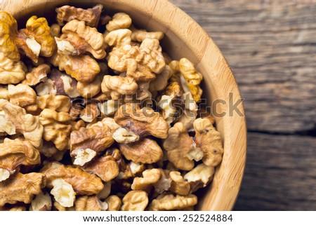 closeup of peeled walnuts in bowl - stock photo