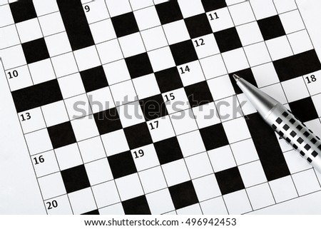 closeup of pen on blank crossword puzzle