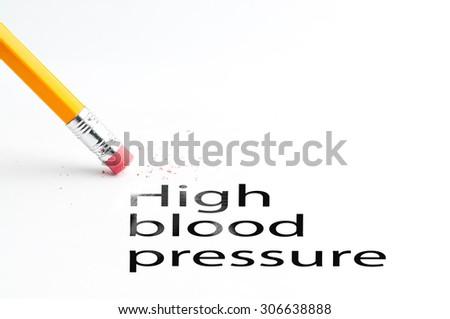 Closeup of pencil eraser and black high blood pressure text. High blood pressure. Pencil with eraser. - stock photo