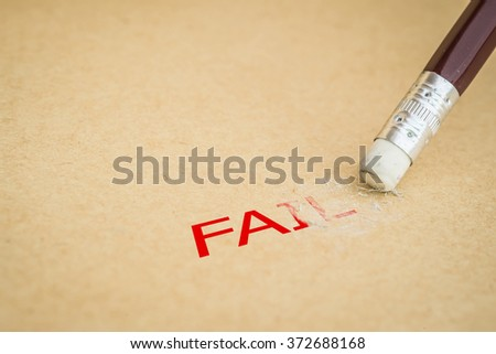Closeup of pencil eraser and the word FAIL, soft focus - stock photo