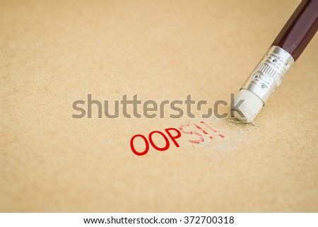 Closeup of pencil eraser and the word OOPS , soft focus - stock photo