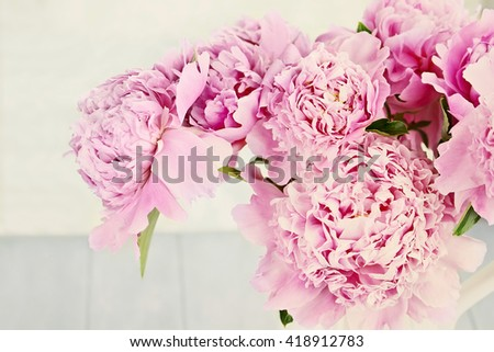 Closeup of peony flowers in a vase.