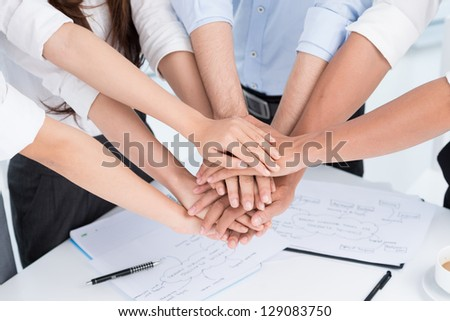 Closeup of people's hands working together - stock photo