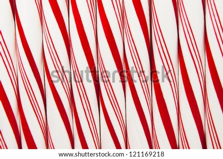 Closeup of peppermint candy canes side by side. - stock photo