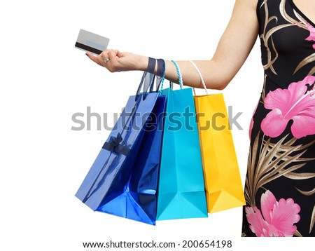 closeup of picture of woman with shopping bags and credit card - stock photo