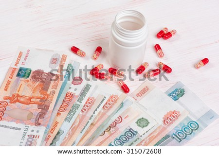 closeup of Pills and money. Health care concept - stock photo