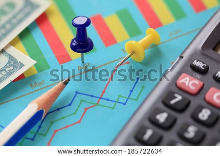 closeup of pin on graph document - stock photo