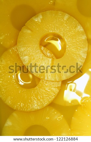 Closeup of pineapple slices in natural juice - stock photo