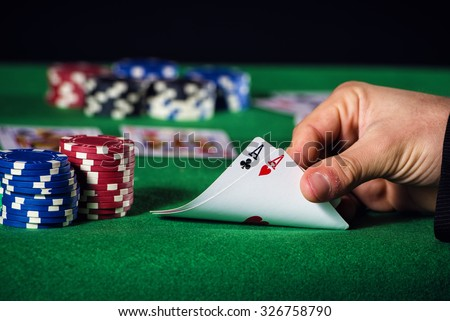 Closeup of poker player with two ace. - stock photo