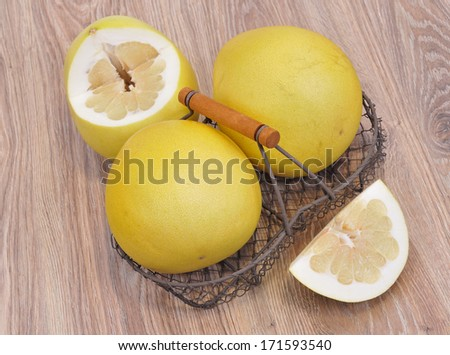 Closeup of pomelo  on wooden background  - stock photo