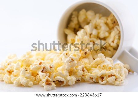 Closeup of popcorn in the cup on white background