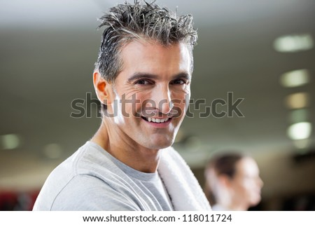 Closeup of portrait of mature man smiling at health club