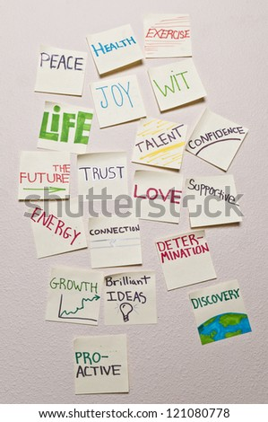 Closeup of positive sticky notes - Health, peace, exercise, joy, wit, life, the future, trust, talent, confidence, energy, connection, love, supportive, growth, growth, proactive, discovery. - stock photo