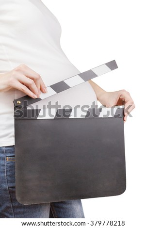 Closeup of pregnant woman holding blank clapperboard isolated on white background - stock photo
