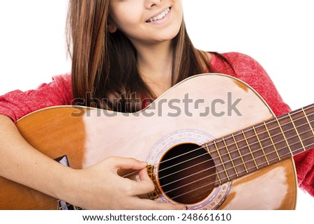 Closeup of pretty teenage girl playing an acoustic guitar  isolated over white background - stock photo