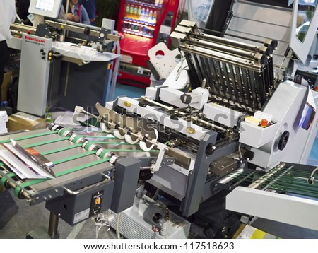 Closeup of printng machine working part with white light