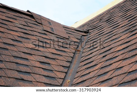 Closeup of problem areas for  waterproofing new installed bitumen roof shingles. Roofing corner works. - stock photo