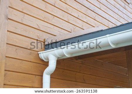 Closeup of problem areas for white rain gutter waterproofing. - stock photo