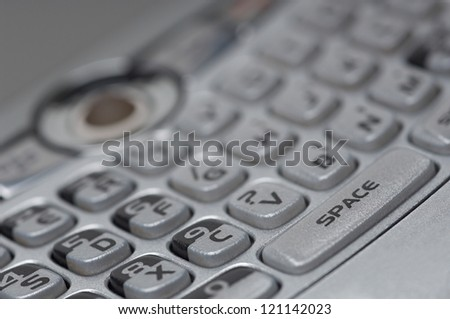 Closeup of push buttons cell phone keypad