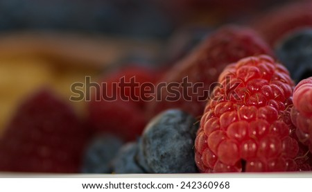 Closeup Of Raspberries With Blueberries