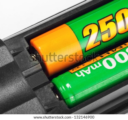 Closeup of rechargeable batteries in remote control - stock photo