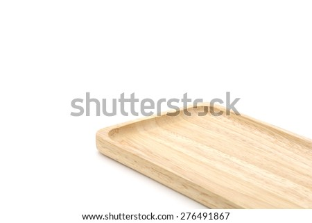 Closeup of rectangle wooden tray on white background on bottom right.