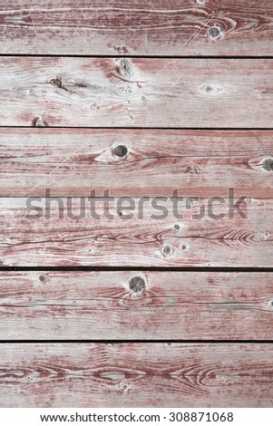 Closeup of red colored timbered fence with knots. Wooden background - stock photo