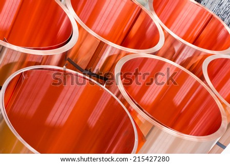 closeup of red copper sheet in rolls - stock photo