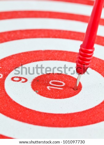 Closeup of red dart on the target - stock photo