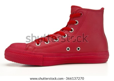 Closeup of red hightop sneaker on white background - stock photo
