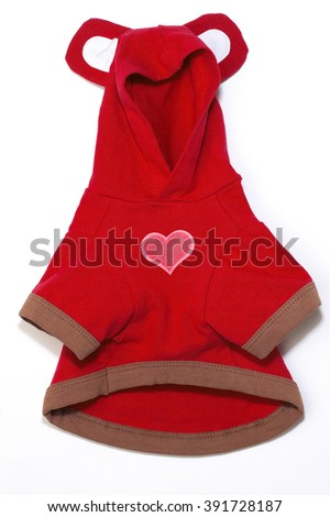 Closeup of red hooded dog outfit on white background