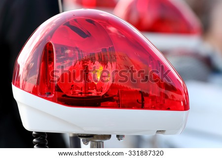 Closeup of red police light, police siren - stock photo