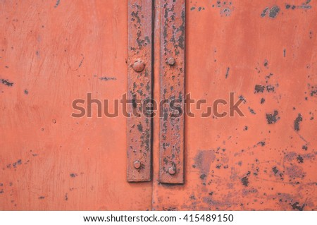 Closeup of red rusty metal with knobs
