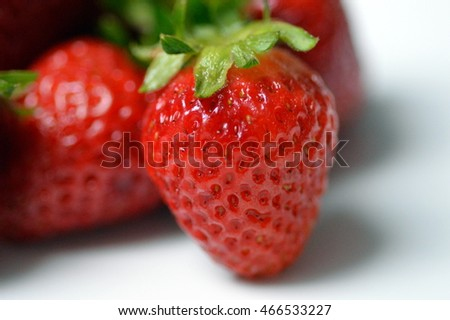 Closeup of red strawberries on a white background