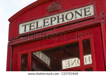 Closeup of red vintage telephone kiosk