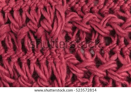 closeup of red woolen knitted fabric, red yarn
