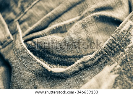 Closeup of Retro style blue jeans pocket, selective focus