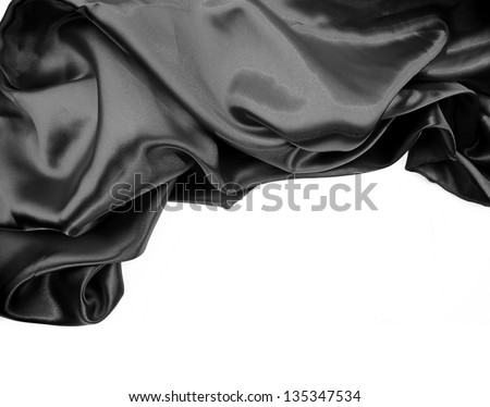 Closeup of rippled black silk fabric on plain background - stock photo