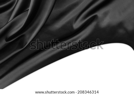 Closeup of rippled black silk fabric on plain background - stock photo