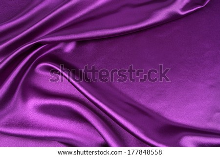 Closeup of rippled purple silk fabric - stock photo