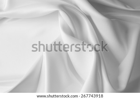 Closeup of rippled white satin silk fabric - stock photo
