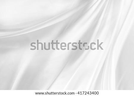 Closeup of rippled white silk fabric - stock photo