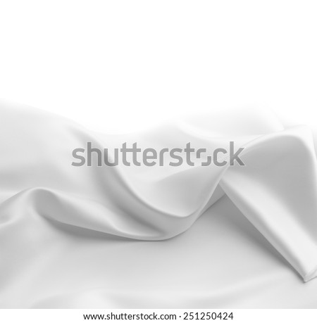 Closeup of rippled white silk fabric. Copy space
