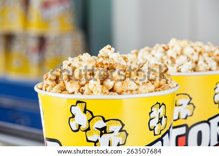 Closeup of roasted popcorns filled in buckets at cinema - stock photo