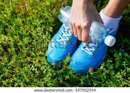 Closeup of running shoes on grass - concept image