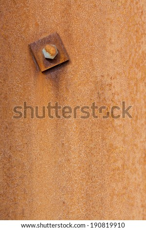 Closeup of rusty metal texture background with bolt - stock photo