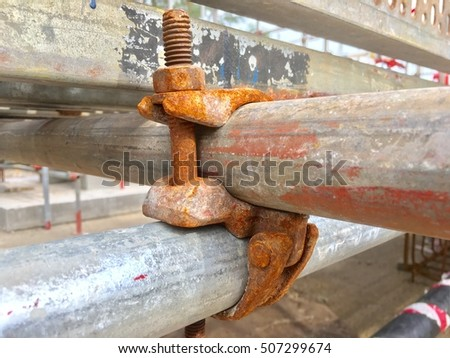 closeup of rusty scaffold in a construction site.