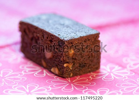 Closeup of s brownie on pink background