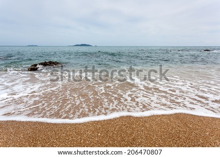 Closeup of sand and small wave