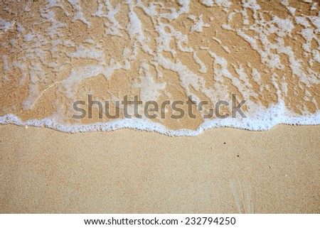 Closeup of sand and small wave  - stock photo